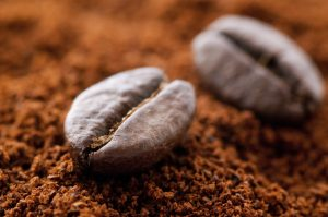 Roasted coffee bean with milled coffee as closeup